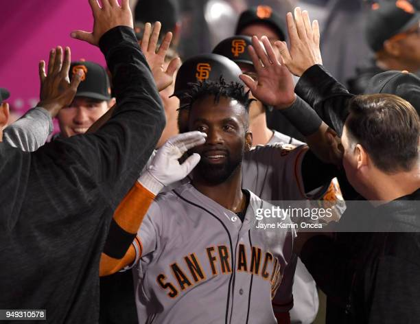 Andrew McCutchen of the San Francisco Giants is greeted in the dugout after a three run home run in the fifth inning of the game against the Los...