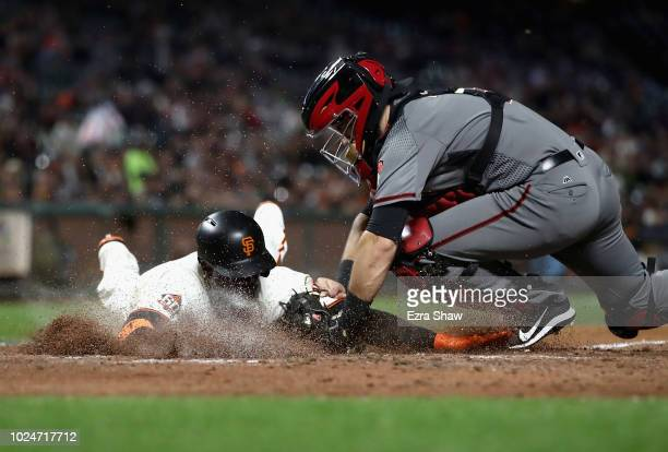 Andrew McCutchen of the San Francisco Giants is tagged out by Alex Avila of the Arizona Diamondbacks when McCutchen tried to score on ground ball hit...