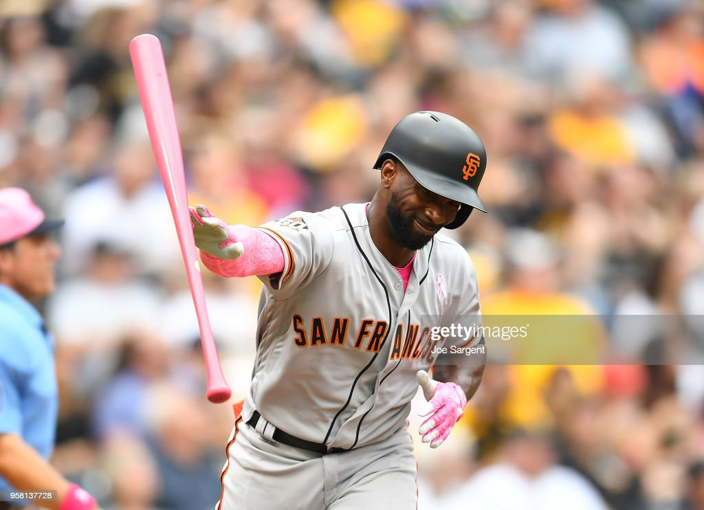 Andrew McCutchen #22 of the San Francisco Giants reacts after hitting a fly ball during the sixth inning against the Pittsburgh Pirates at PNC Park on May 13, 2018 in Pittsburgh, Pennsylvania.