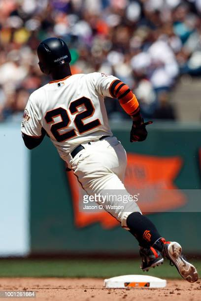 Andrew McCutchen of the San Francisco Giants rounds second base against the Oakland Athletics during the fourth inning at ATT Park on July 15 2018 in...