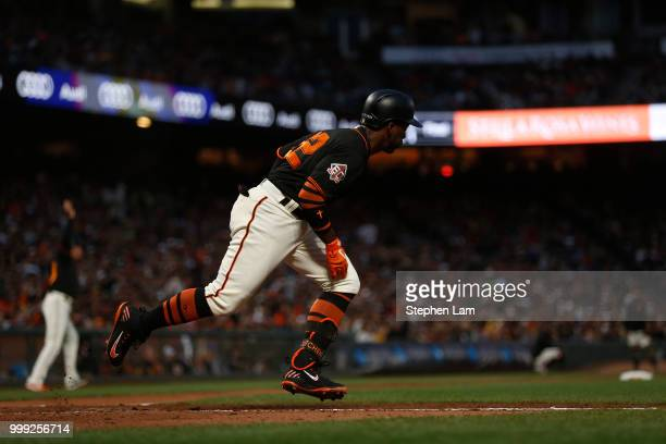 Andrew McCutchen of the San Francisco Giants runs towards first base during the fourth inning against the Oakland Athletics at ATT Park on July 14...