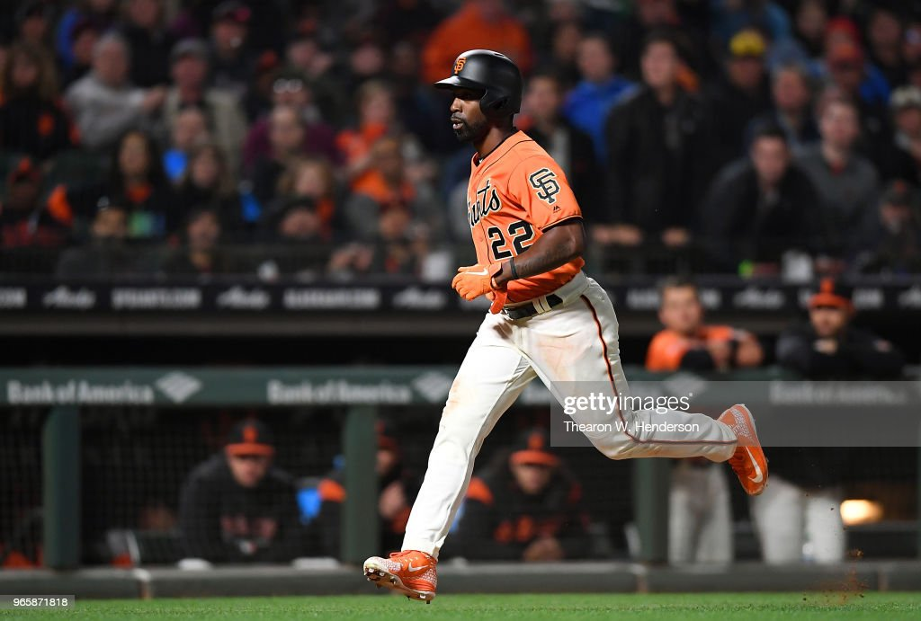 Andrew McCutchen #22 of the San Francisco Giants scores from third base on a wild pitch against the Philadelphia Phillies in the bottom of the seventh inning at AT&T Park on June 1, 2018 in San Francisco, California.