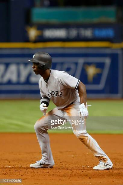 Andrew McCutchen of the Yankees leads off first base during the MLB regular season game between the New York Yankees and the Tampa Bay Rays on...