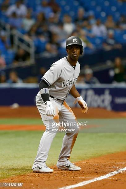 Andrew McCutchen of the Yankees leads off third base during the MLB regular season game between the New York Yankees and the Tampa Bay Rays on...