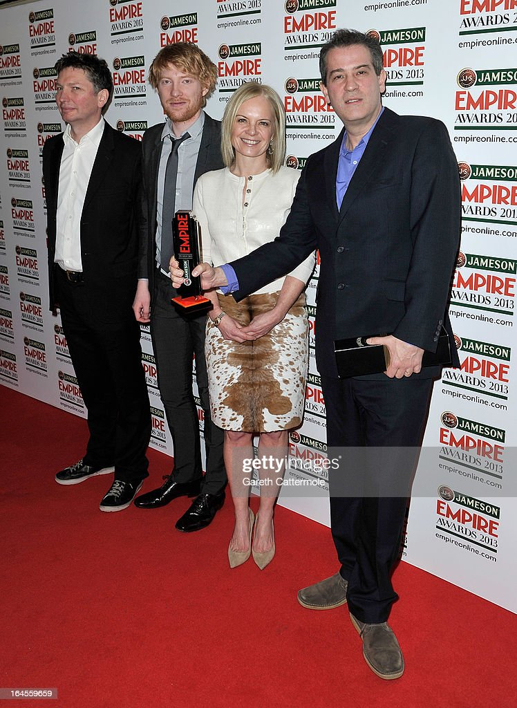 Andrew McDonald (L) and Allon Reich (R) with the Art of 3D award for Dredd 3D with presenters Domhnall Gleeson and Mariella Frostrup at the Jameson Empire Awards 2013 at Grosvenor House on March 24, 2013 in London, England.