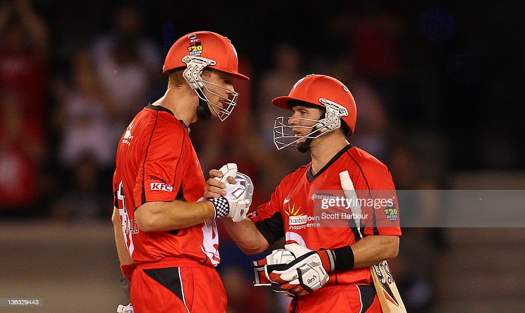 Andrew McDonald and Brad Hodge of the Renegades celebrate after winning the T20 Big Bash League match between the Melbourne Renegades and the Sydney Sixers at Etihad Stadium on January 2, 2012 in Melbourne, Australia.