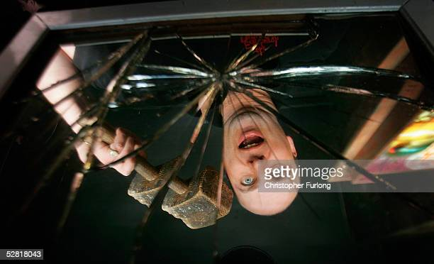 Andrew McDonald of Edinburgh Dungeon smashes a mirror with a mallet to dispel the superstition of seven years bad luck on May 13 2005 in Edinburgh...