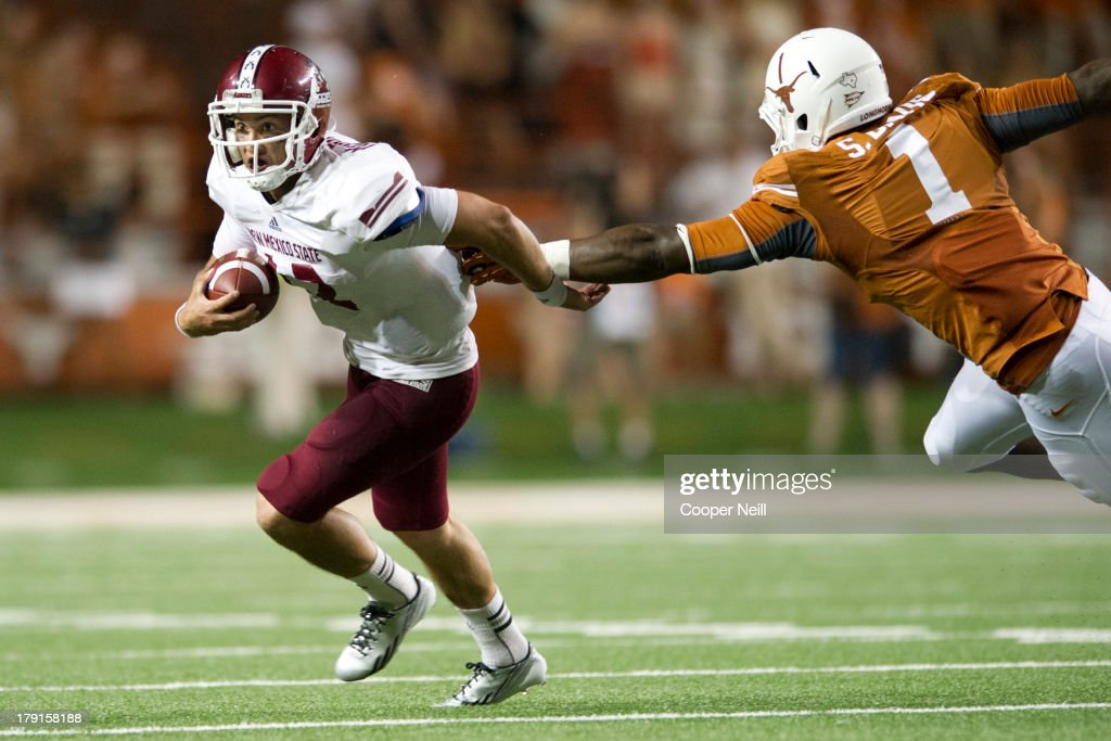 Andrew McDonald #12 of the New Mexico State Aggies escapes the Texas Longhorns defense on August 31, 2013 at Darrell K Royal-Texas Memorial Stadium in Austin, Texas.