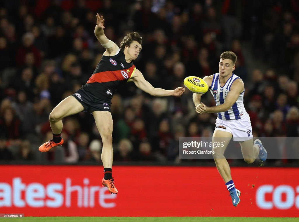 Andrew McGrath of the Bombers and Shaun Atley of the Kangaroos compete for the ball during the round 18 AFL match between the Essendon Bombers and the North Melbourne Kangaroos at Etihad Stadium on July 22, 2017 in Melbourne, Australia.