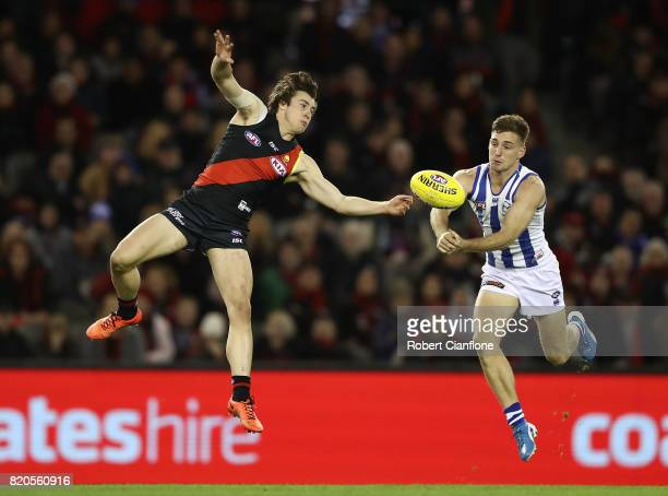 Andrew McGrath of the Bombers and Shaun Atley of the Kangaroos compete for the ball during the round 18 AFL match between the Essendon Bombers and...