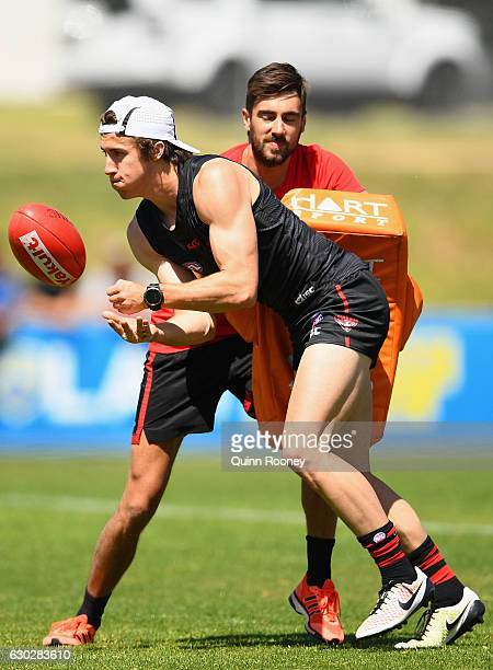 Andrew McGrath of the Bombers handballs during an Essendon Bombers AFL Christmas Open training Session at True Value Solar Centre on December 20 2016...
