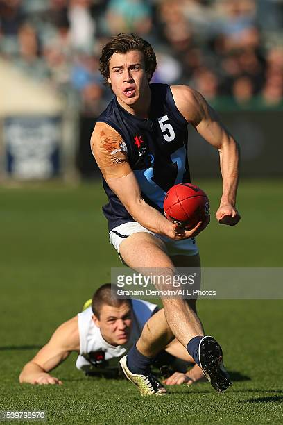 Andrew McGrath of Vic Metro handballs during the Under 18's AFL match between Vic Country and Vic Metro at Simonds Stadium on June 13 2016 in Geelong...