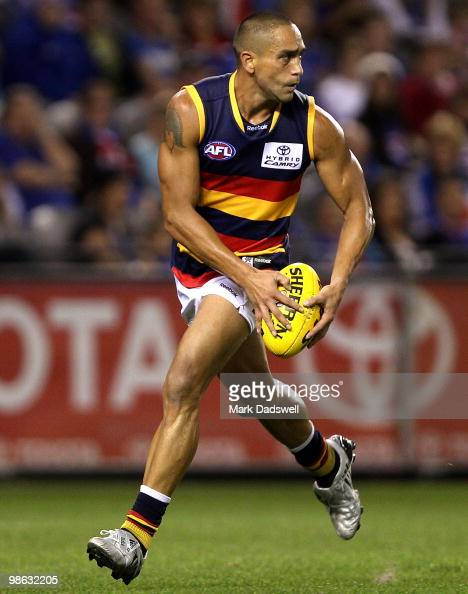 Andrew McLeod of the Crows looks for a teammate during the