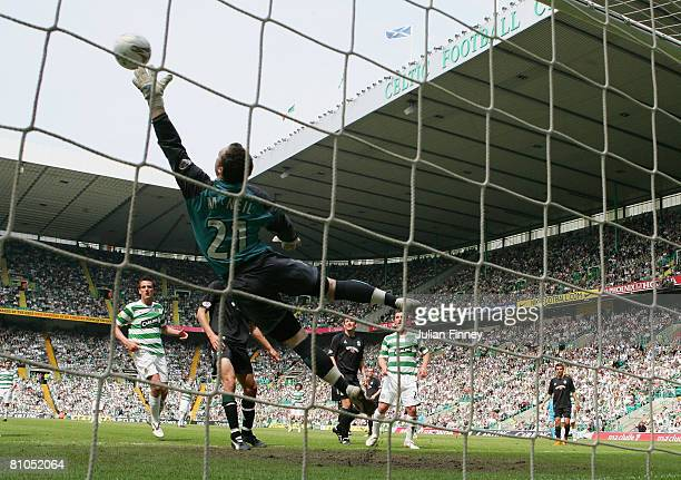 Andrew McNeil goalkeeper of Hibernian saves a Shunsuke Nakamura of Celtic free kick during The Clydesdale Bank Scottish Premier League match between...