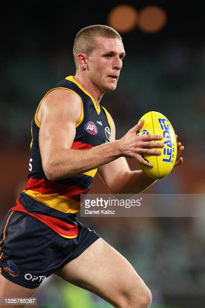 Andrew McPherson of the Crows runs with the ball during the round 23 AFL match between Adelaide Crows and North Melbourne Kangaroos at Adelaide Oval...