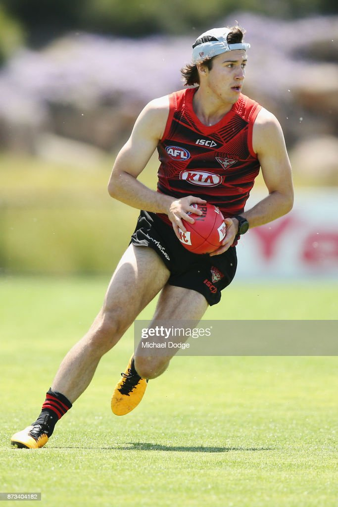 Andrew MGrath of the Bombers runs with the ball during an Essendon Bombers AFL training session at the Essendon Football Club on November 13, 2017 in Melbourne, Australia.