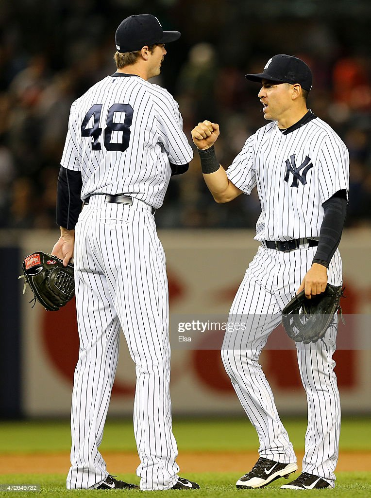 Andrew Miller #48 and Jacoby Ellsbury #22 of the New York Yankees celebrate the win over the Baltimore Orioles on May 8, 2015 at Yankee Stadium in the Bronx borough of New York City.The New York Yankees defeated the Baltimore Orioles 5-4.