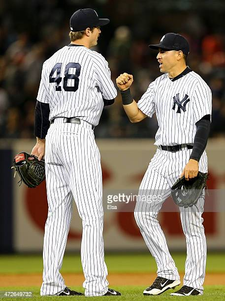 Andrew Miller and Jacoby Ellsbury of the New York Yankees celebrate the win over the Baltimore Orioles on May 8 2015 at Yankee Stadium in the Bronx...