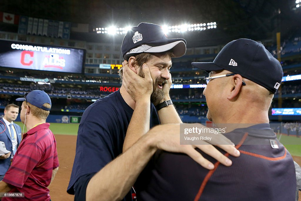 Andrew Miller #24 and Manager Terry Francona #17 of the Cleveland Indians celebrate after defeating the Toronto Blue Jays with a score of 3 to 0 in game five to the American League Championship Series at Rogers Centre on October 19, 2016 in Toronto, Canada.