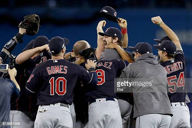 Andrew Miller of the Cleveland Indians celebrates with his teammates after defeating the Toronto Blue Jays with a score of 3 to 0 in game five of the...