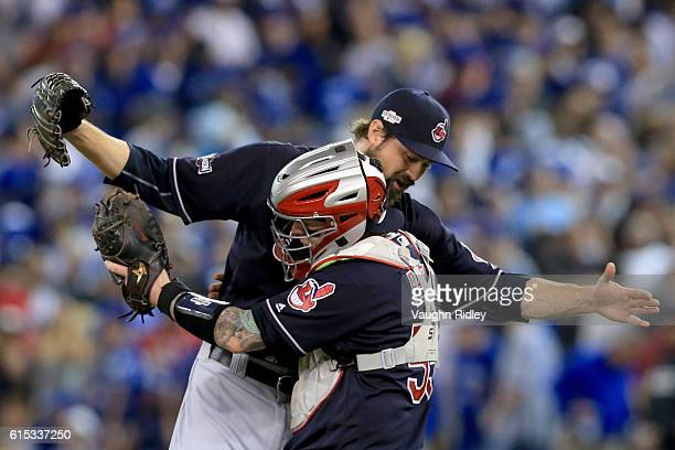 Andrew Miller of the Cleveland Indians celebrates with teammate Roberto Perez after defeating the Toronto Blue Jays with a score of 4 to 2 in game...