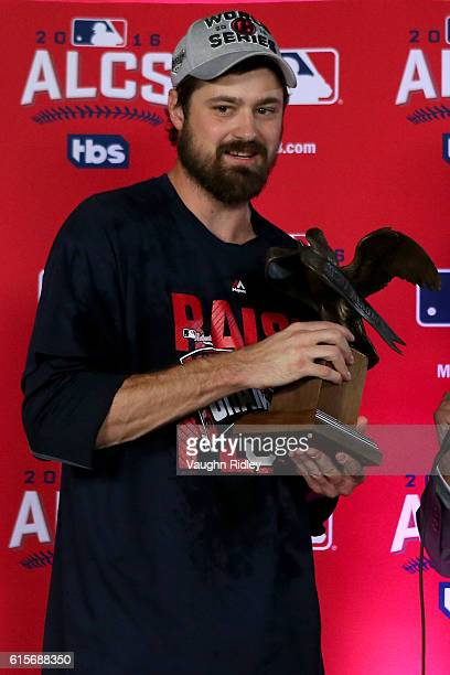 Andrew Miller of the Cleveland Indians is handed the William Harridge Trophy after defeating the Toronto Blue Jays in game five to win the American...