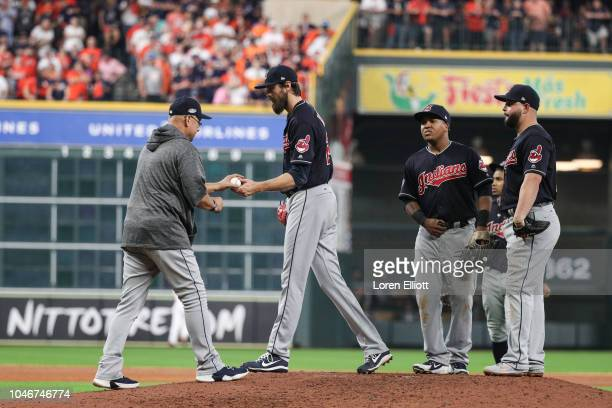 Andrew Miller of the Cleveland Indians is removed from the game in the sixth inning during Game 2 of the ALDS against the Houston Astros at Minute...