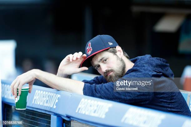 Andrew Miller of the Cleveland Indians looks on from the dugout before the start of the game against the Los Angeles Angels of Anaheim at Progressive...