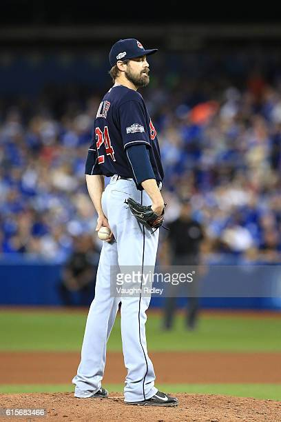 Andrew Miller of the Cleveland Indians looks to throw a pitch in the seventh inning against the Toronto Blue Jays during game five of the American...