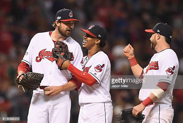 Andrew Miller of the Cleveland Indians reacts with Francisco Lindor and Jason Kipnis in the seventh inning against the Boston Red Sox during game one...