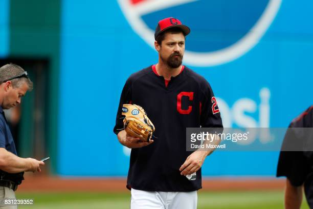 Andrew Miller of the Cleveland Indians takes the field with pitchers warming up before the game against the New York Yankees at Progressive Field on...
