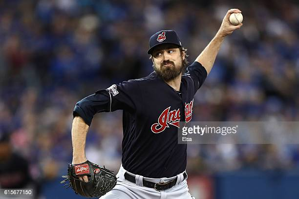 Andrew Miller of the Cleveland Indians throws a pitch in the seventh inning against the Toronto Blue Jays during game five of the American League...