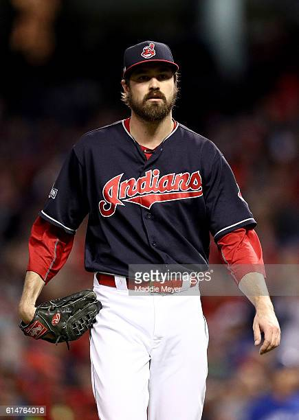 Andrew Miller of the Cleveland Indians walks to the dugout after pitching in the seventh inning against the Toronto Blue Jays during game one of the...