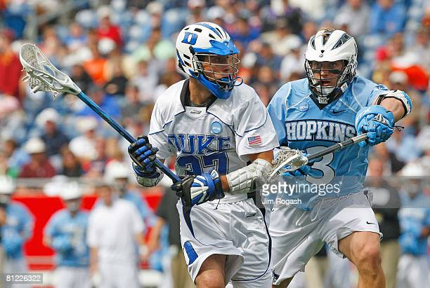 Andrew Miller of the Johns Hopkins Blue Jays defends against Mike Hanley of the Duke Blue Devils during NCAA Lacrosse Semifinals at Gillette Stadium...