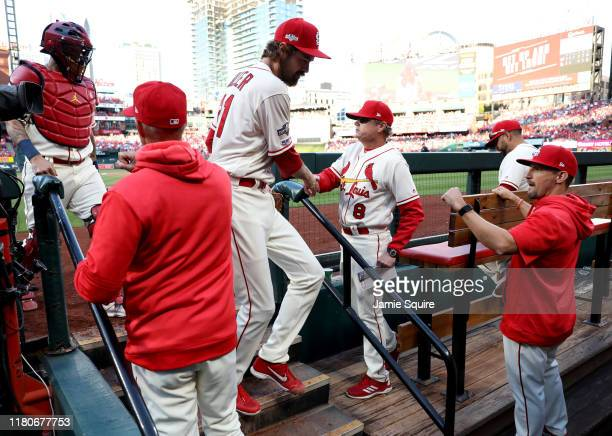 Andrew Miller of the St Louis Cardinals congratulated by manager Mike Shildt after getting out of the eighth inning of game two of the National...