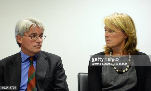 Andrew Mitchell and his wife Dr Sharon Bennett during a press conference in London, as he gives his reaction to the Crown Prosecution Service...