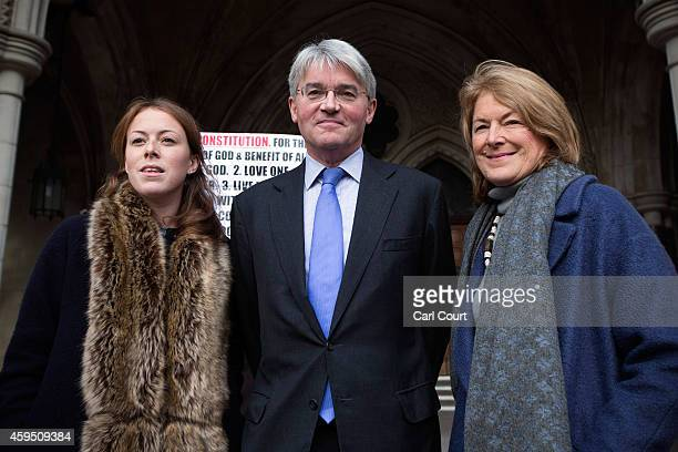 Andrew Mitchell his wife Dr Sharon Bennett and a woman believed to be their daughter arrive at the High Court on November 24 2014 in London England...