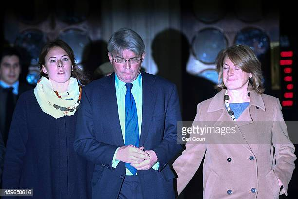 Andrew Mitchell , his wife Dr Sharon Bennett and a woman believed to be his daughter leave the High Court on November 27, 2014 in London, England. A...