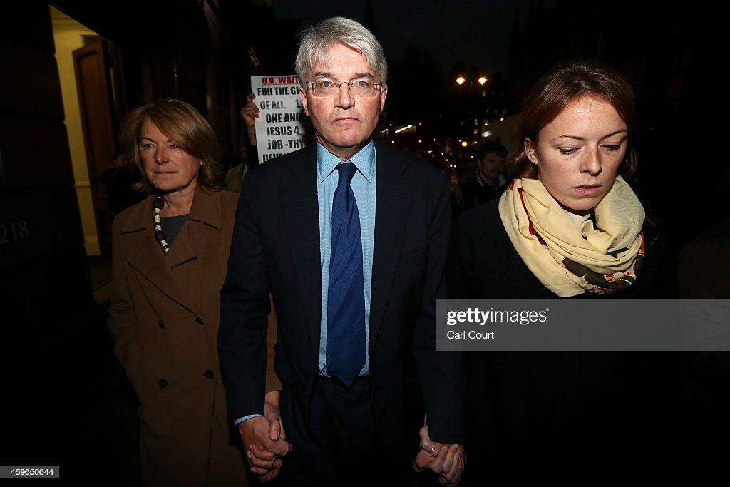 Andrew Mitchell (C), his wife Dr Sharon Bennett (L) and a woman believed to be his daughter (R) leave the High Court on November 27, 2014 in London, England. A judge has ruled that Andrew Mitchell probably did call police officers 'plebs', as he ruled against the Tory MP in a High Court libel action.