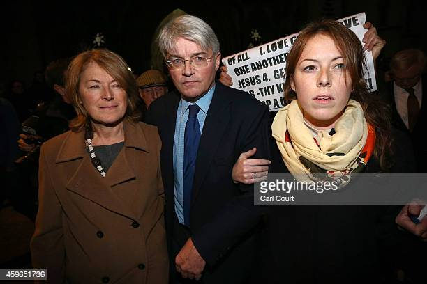 Andrew Mitchell his wife Dr Sharon Bennett and a woman believed to be his daughter leave the High Court on November 27 2014 in London England A judge...