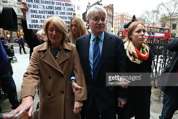 Andrew Mitchell , his wife Dr Sharon Bennett and other family members arrive at the High Court on November 27, 2014 in London, England. A verdict is...