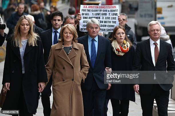 Andrew Mitchell , his wife Dr Sharon Bennett , family members and fellow parliamentarian David Davis arrive at the High Court on November 27, 2014 in...