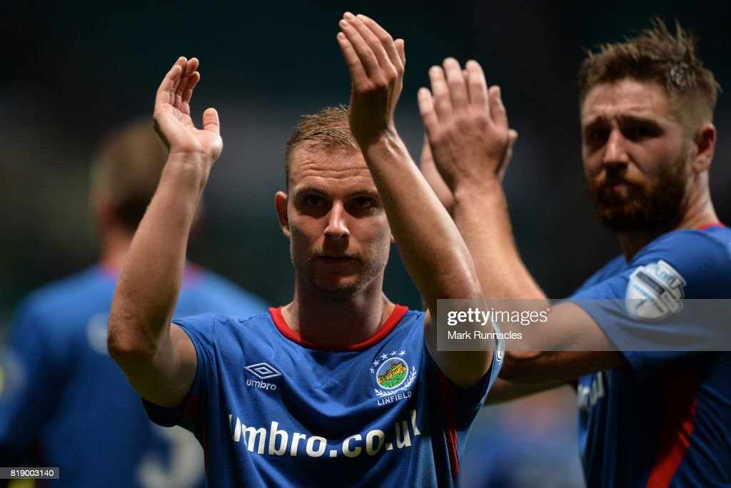 Andrew Mitchell of Linfield takes on Scott Brown of Celtic during the UEFA Champions League Qualifying Second Round, Second Leg match between Celtic and Linfield at Celtic Park Stadium on July 19, 2017 in Glasgow, Scotland.
