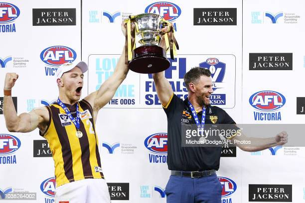 Andrew Moore of the Box Hill Hawks and Box Hill coach Chris Newman celebrate the win with the premiership cup during the VFL Grand Final match...