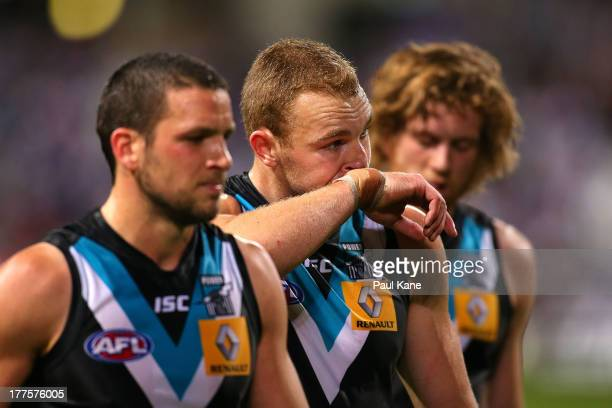 Andrew Moore of the Power looks on as he walks from the field after being defeated during the round 22 AFL match between the Fremantle Dockers and...