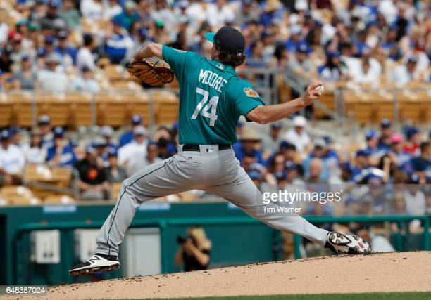 Andrew Moore of the Seattle Mariners pitches in the first inning against the Los Angeles Dodgers during the spring training game at Camelback Ranch...