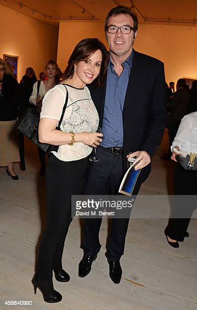 Andrew Morton and wife Carolyn attend a private view of 'And The Stars Shine Down' by Stasha Palos at the Saatchi Gallery on December 2 2014 in...