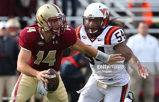 Andrew Motuapuaka of the Virginia Tech Hokies chases John Fadule of the Boston College Eagles in the second half at Alumni Stadium on October 31 2015...