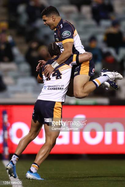 Andrew Muirhead of the Brumbies celebrates with team mate Noah Lolesio after scoring a try during the round one Super Rugby AU match between the...