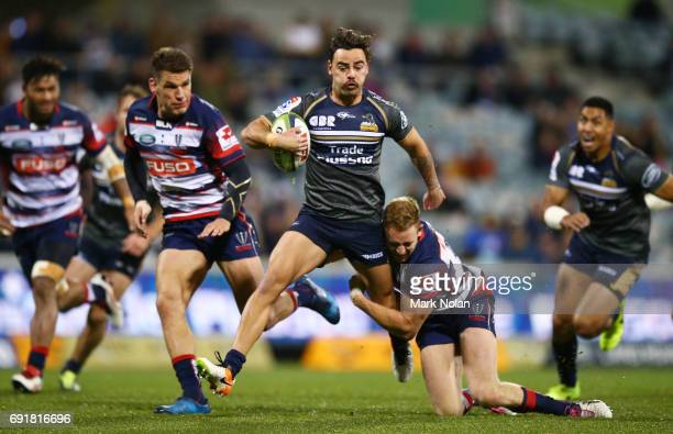 Andrew Muirhead of the Brumbies makes a line break during the round 15 Super Rugby match between the Brumbies and the Rebels at GIO Stadium on June 3...
